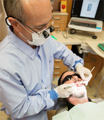 Dentist in Newport Oregon Performing an Exam