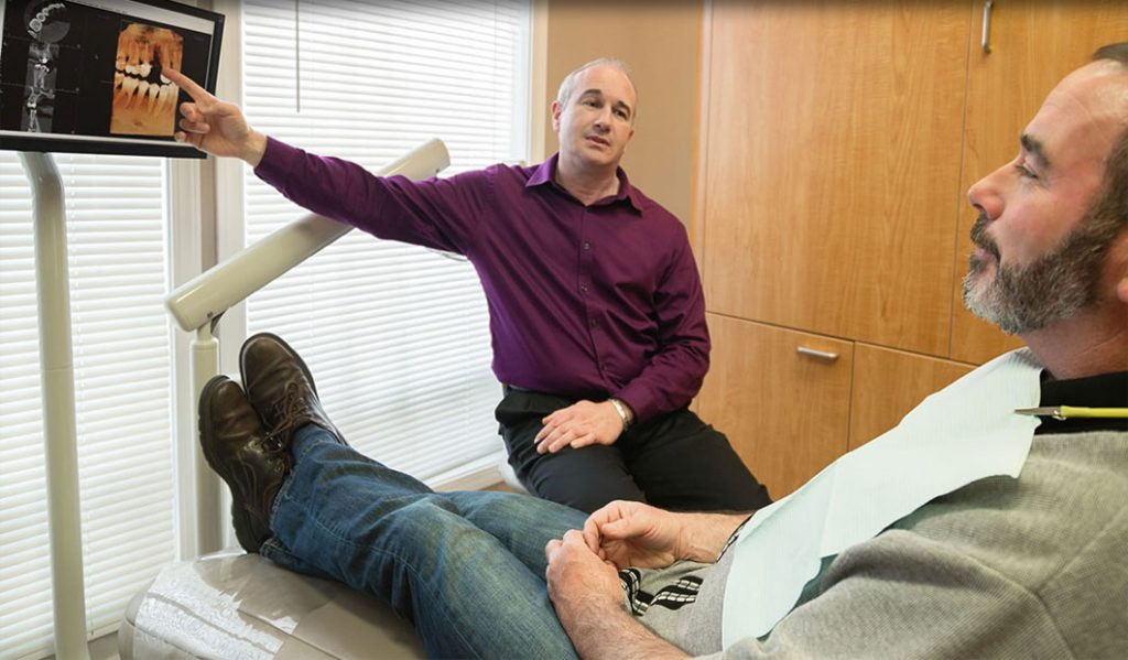 Dentist Explains X-Rays to Dental Care Patient at Our Newport Oregon Dentist Office